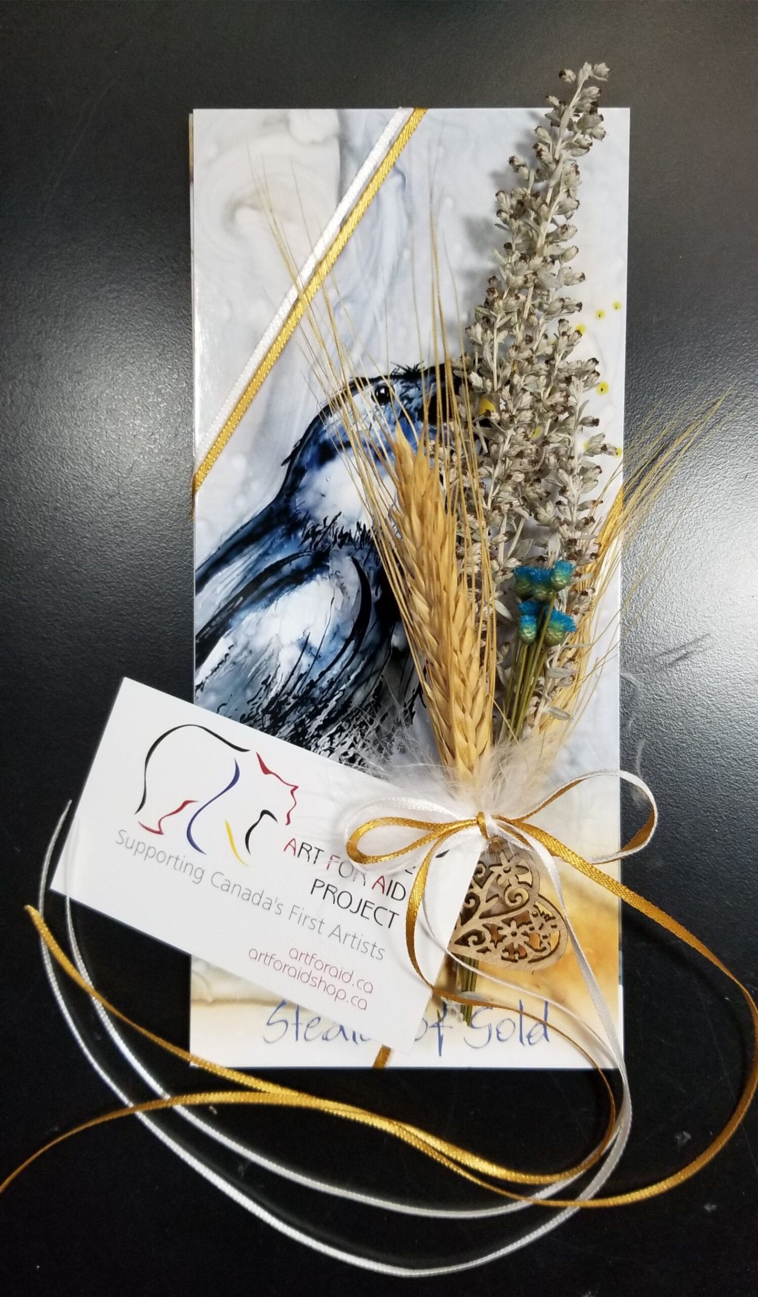 Bookmarks bundle beautifully decorated with ribbon and dried flowers.